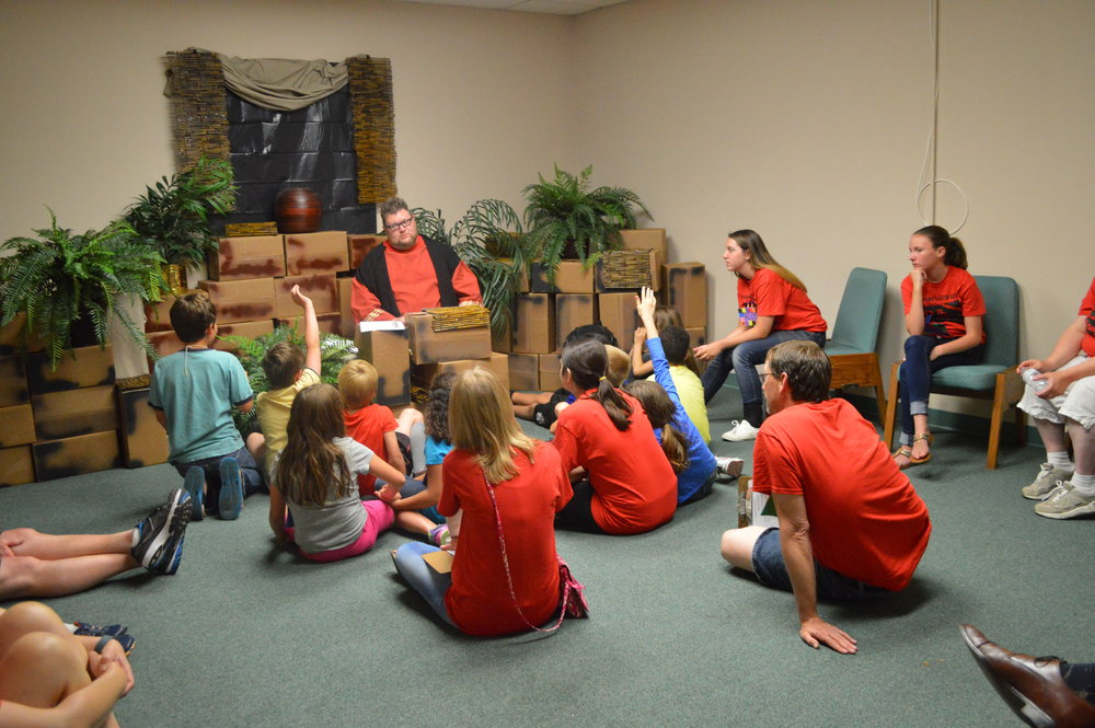 Kids and leaders participating in the Bible lesson during Crossroad's 2016 Vacation Bible School - The Game Changer