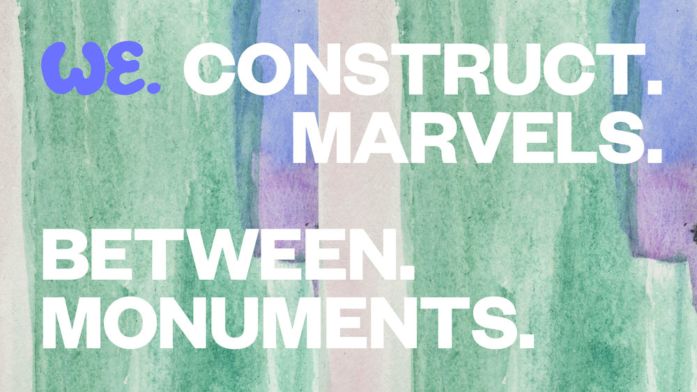 "Image description: rectangular background of watercolor washes of sage green, lavender and periwinkle with the words ""WE."" in bright blue bubble letters and ""CONSTRUCT.MARVELS.BETWEEN.MONUMENTS"" in white block letters."