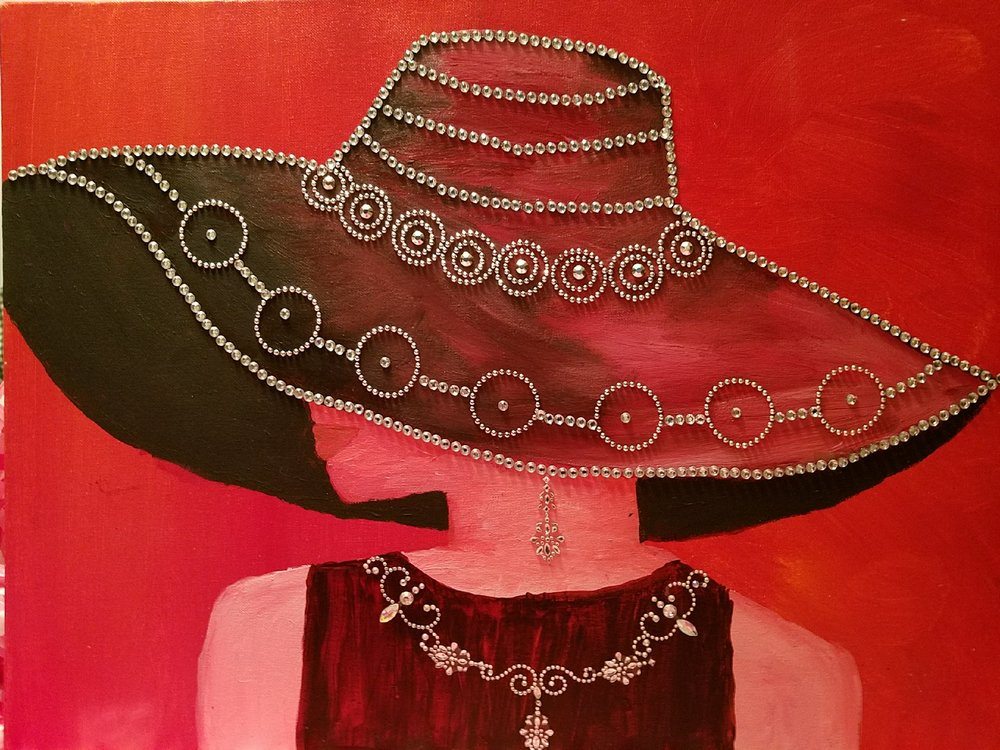 Artwork by Resident Artist Alma Bate. Image description: acrylic painting of a person wearing a big sun hat covering most of their face adorned in silver beads. Tones of the painting are many shades of red.