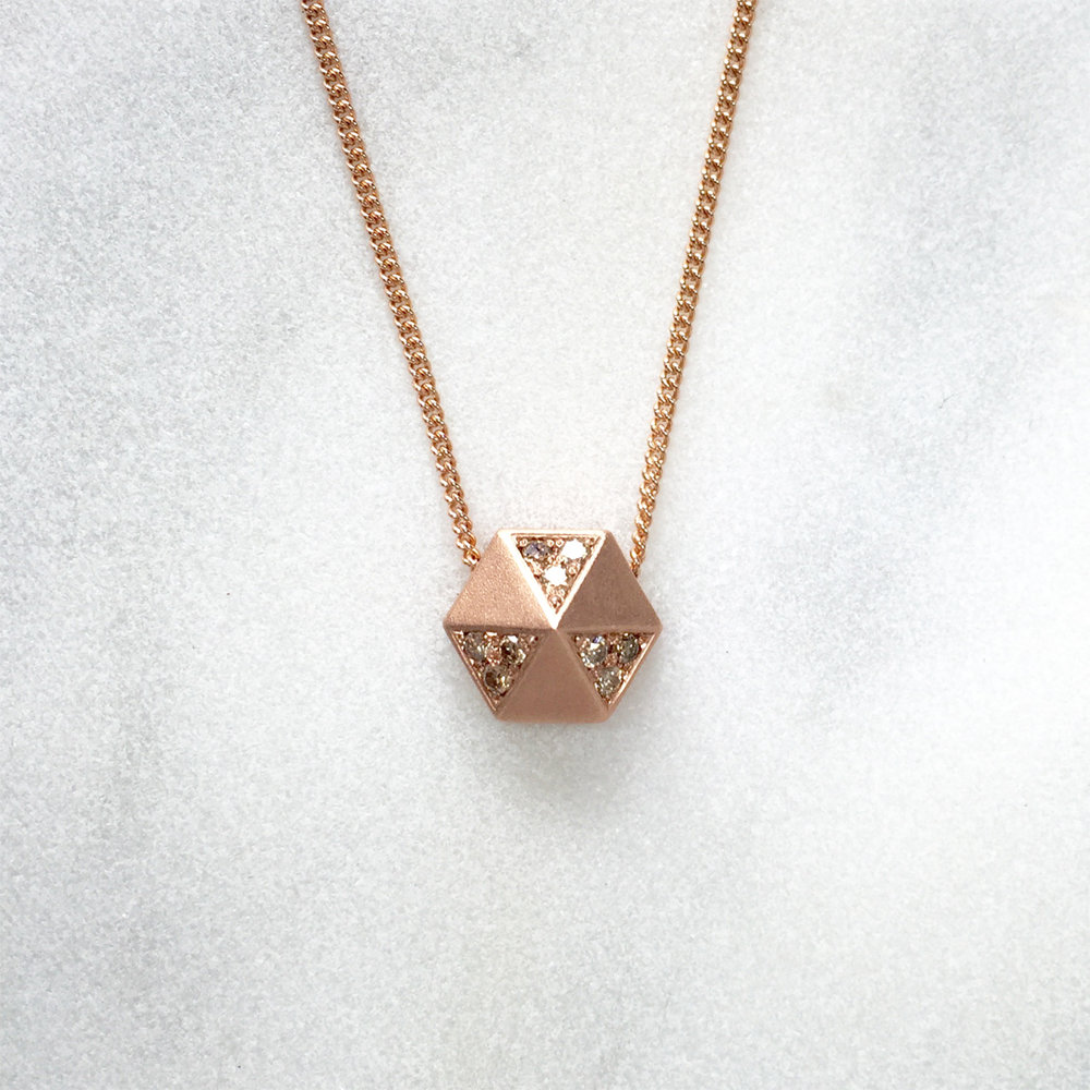 18ct rose gold hex pendant set with cinnamon diamonds.