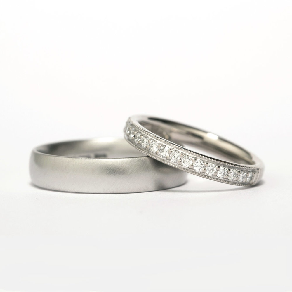 Gents platinum wedding band and ladies platinum wedding band grain set with diamonds.