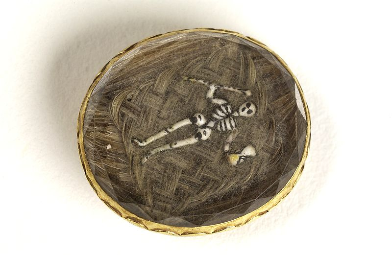 Mourning brooch containing the hair of a deceased relative and enamel skeleton - Wellcome Images