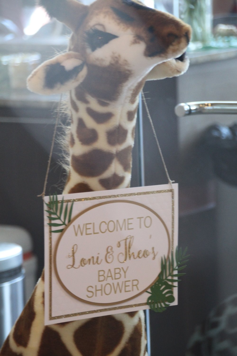 A life-size giraffe with a custom sign welcomed guests to the shower