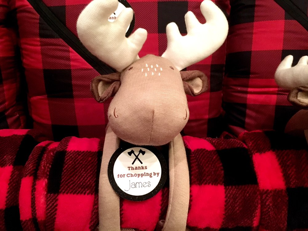 Buffalo check blankets with a moose stuffed animal Favors with custom gift tags made by Serena & James Events