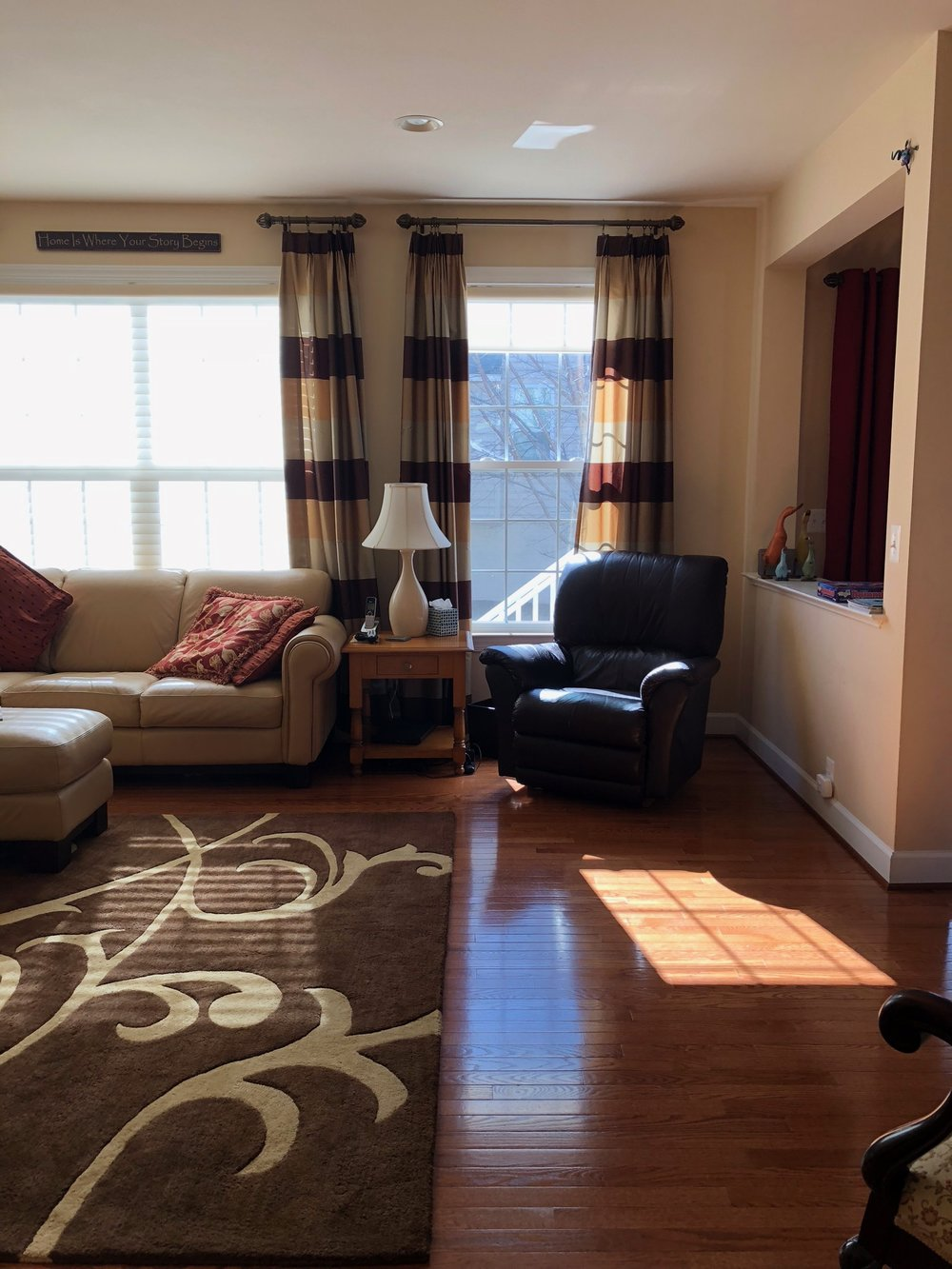 Before, builder grade colors and furniture filled this family room in Herndon, VA.