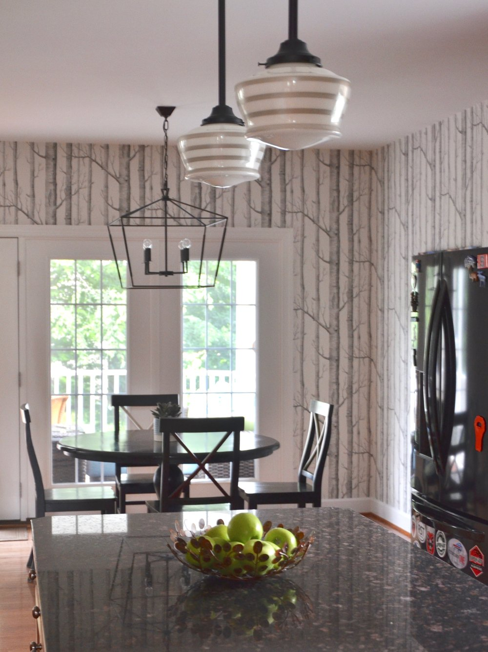 New light fixture over eat-in table, new pendant lighting over kitchen island, new wallpaper by Cole and Sons.