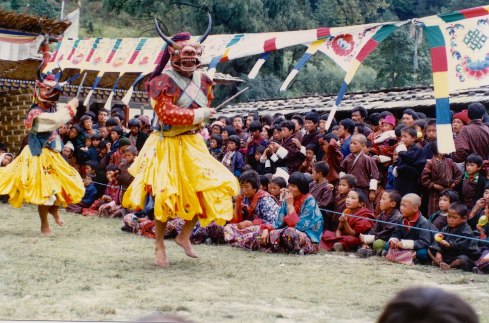 A group of Northern Bhutanese watching the dancers at a Tshechu (religious festival).