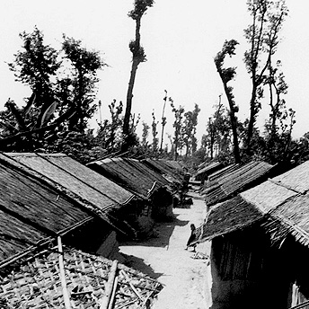Refugee huts are arranged in lines and made out of bamboo and plastic. I have spent 8 years of my life living here and I do not know how many more it will be. We are becoming adults but have only distant dreams of our country. Pasang / PhotoVoice / LWF