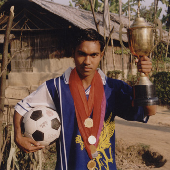 He is the man of the match.  He won a shield at a championship.  Being a refugee he never looses hope of becoming a football star in Bhutan.      Indra / PhotoVoice / LWF