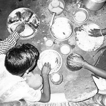 Supper in my hut. We all eat happily together in our small huts even though we are refugees. What can we do? It is difficult to solve our problems. So many years have passed and there has been no progress to solve our situation .   Yethi Raj / PhotoVoice / LWF