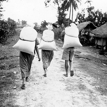 Carrying rations back to the huts.  Praja / PhotoVoice / LWF