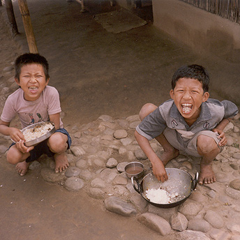 Children eating.   Til Maya / PhotoVoice / LWF