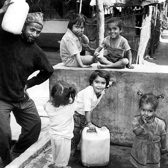 Collecting water. There is a saying that many drops of water together make an ocean. Like that we must share our good ideas to solve our refugee problem.  Aita Singh / PhotoVoice / LWF