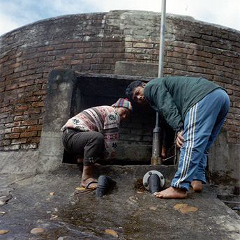 Plumbers maintain the water tank which has been leaking for 2 days    Suresh / PhotoVoice / LWF