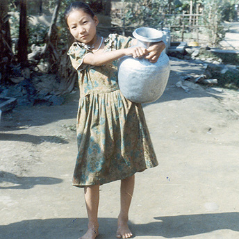 Carrying the water from the tap to the hut.      Menuka / PhotoVoice / LWF