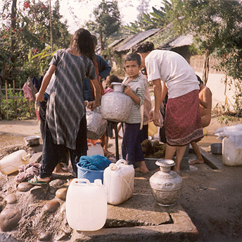 We only get water at certain times of the day. We leave the containers in a line at the tap. If we do not have enough containers there will not be enough water to do all the washing and to take baths.Khina / PhotoVoice / LWF