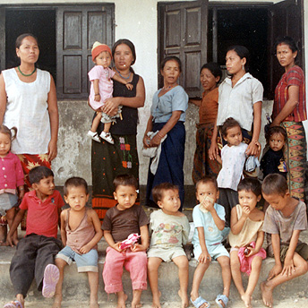 Women queue at the health centre with their children.  Til Maya / PhotoVoice / LWF