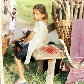 A girl rests from carrying firewood,    Prem / PhotoVoice / LWF