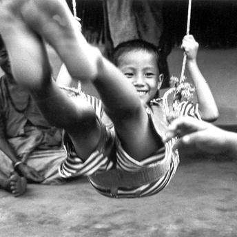 Playing happily on a swing.  Here I am a refugee but I do not want refuge.  I want the wings to fly.   Aite Maya / Devi  / PhotoVoice / LWF