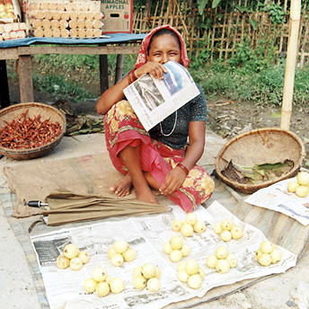 Shopkeeper: A woman selling fruits so she can run her family.    Buddhi/ PhotoVoice / LWF