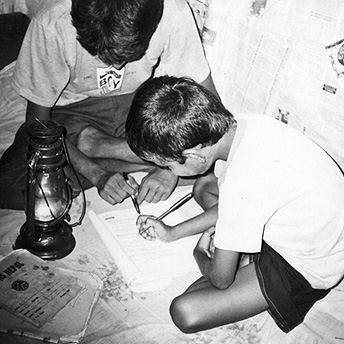 This boy is doing his homework and being helped by his father. Parents are happy to help the school where their children study. They work together to keep the school in good repair to support their children's education.  Prem / PhotoVoice / LWF