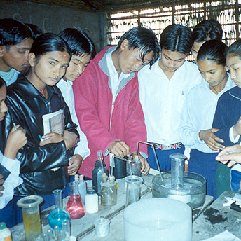 Education without practicals is like rice without curry.  This science teacher teaches practical science in the laboratory.  He explains how to prepare gas.    Menuka / PhotoVoice / LWF