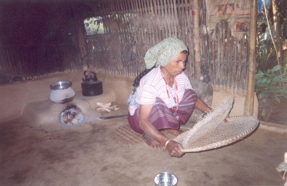 Winnowing and cleaning the rice.  Bhimma / PhotoVoice / LWF