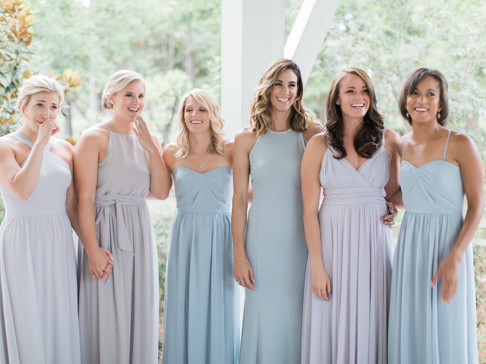 Gorgeous mismatched light gray bridesmaid dresses.
