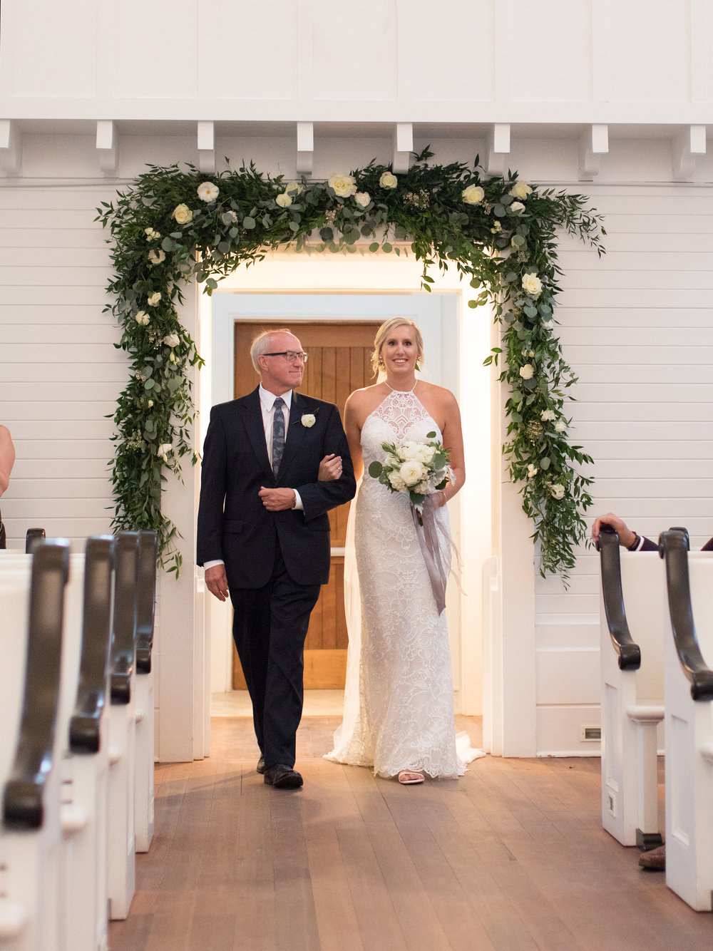 Bride walks down the aisle in Seaside Chapel