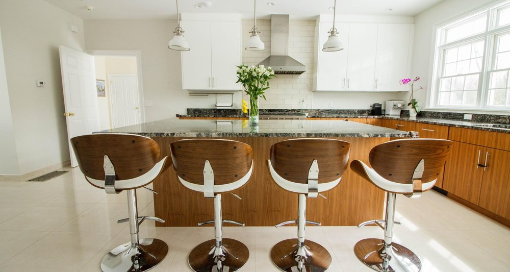 fabulous midcentury kitchen counter stools in white and walnut kitchen Greenwich CT - Curry and Kingston Cabinetry