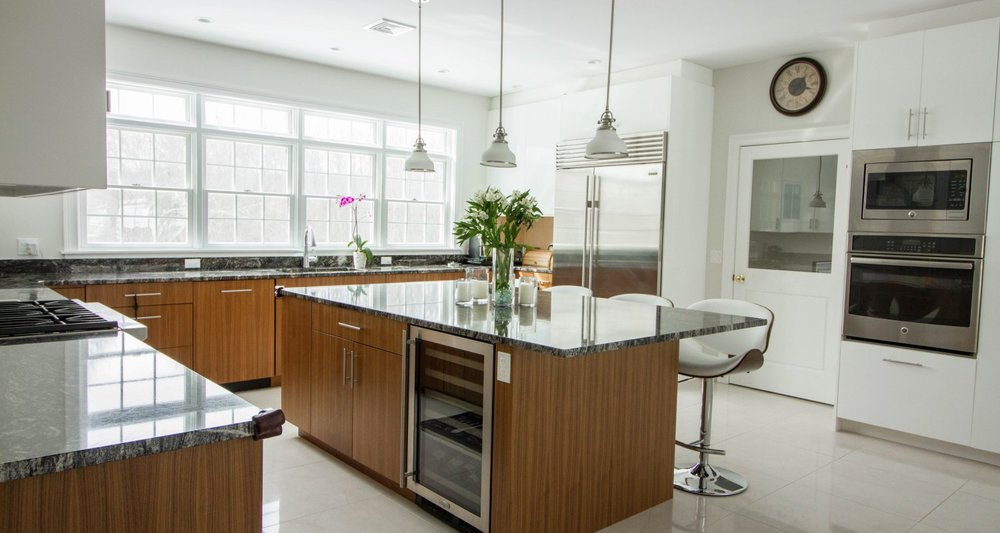 White lacquer and quartersawn walnut family sized kitchen Greenwich CT - Curry & Kingston Cabinetry