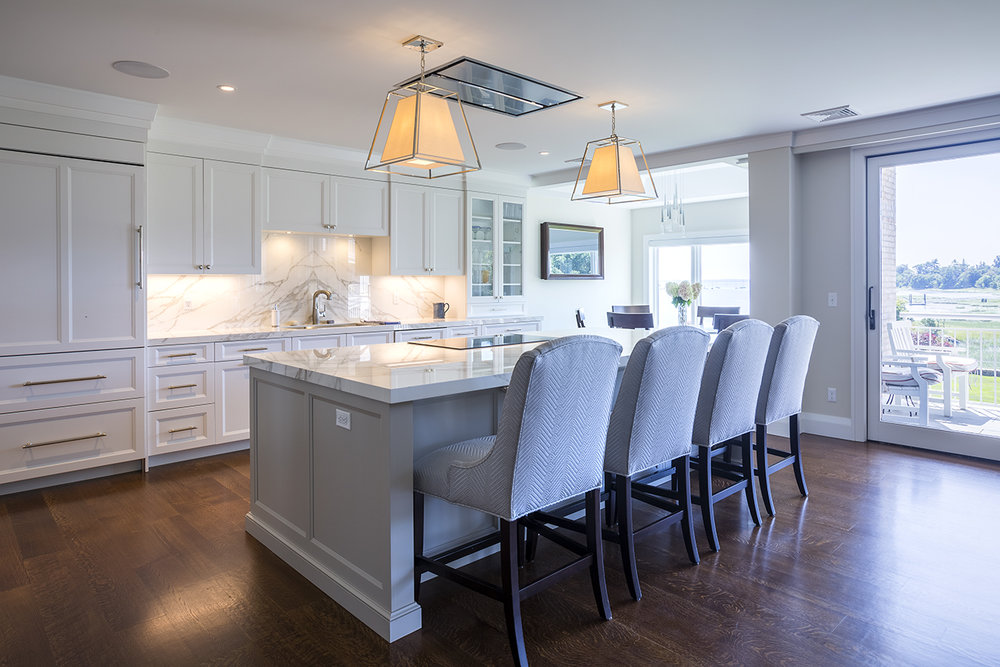 Transitional condo kitchen remodel with polished nickel and neolith counters Greenwich CT