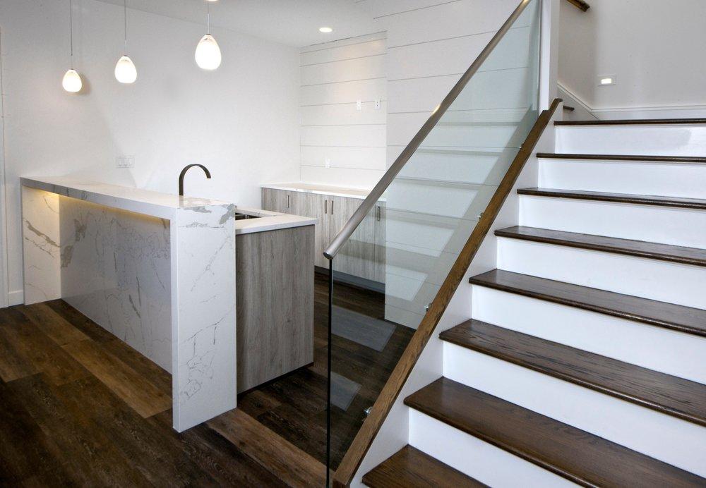 bar-basement-waterfall-countertop-led-lighting-glass-stairrail-greenwich.jpg