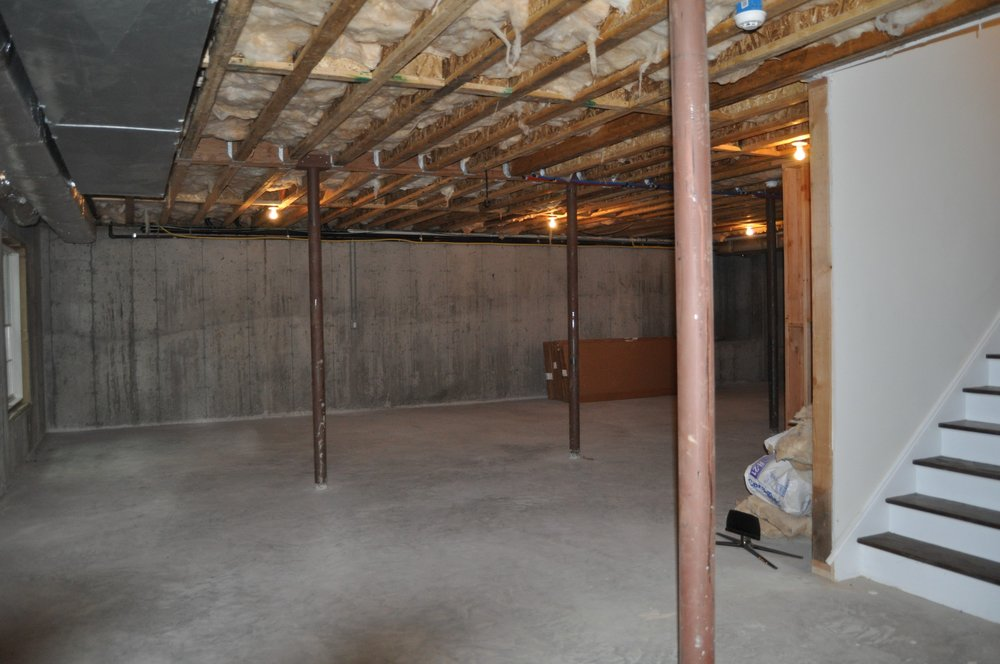 A drab concrete basement was totally renovated to create a new bar area with wine room and media room