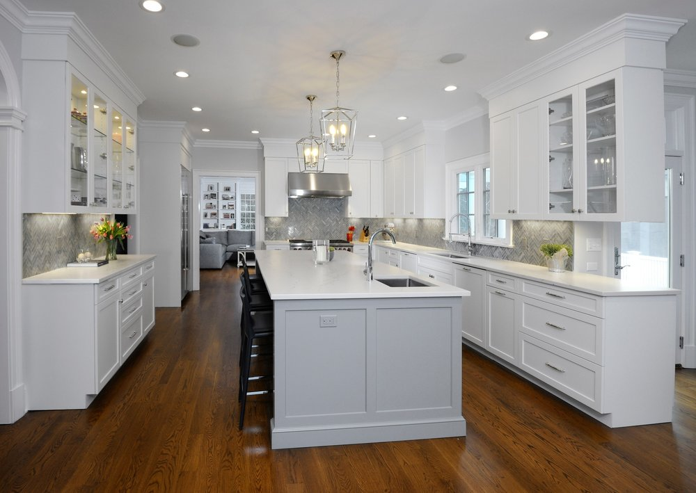 white_custom_kitchen_gray_island_darlana_polished_nichel_lantern_pendants.jpg