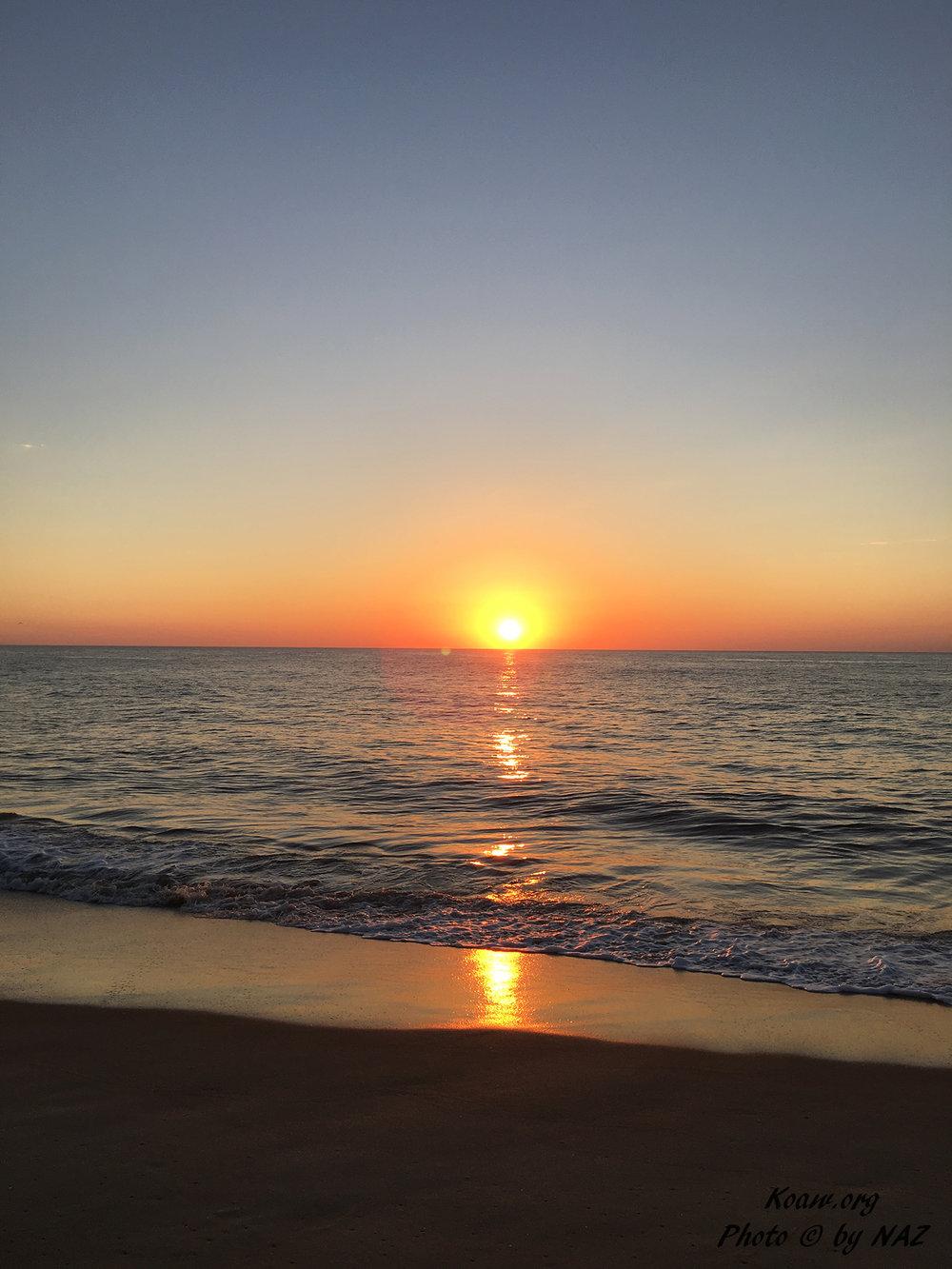 Atlantic Ocean sunrise.   ©  Photo by   Natalie Z.