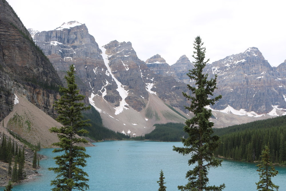 Lake Moraine Banff National Park with mountain range and evergreens