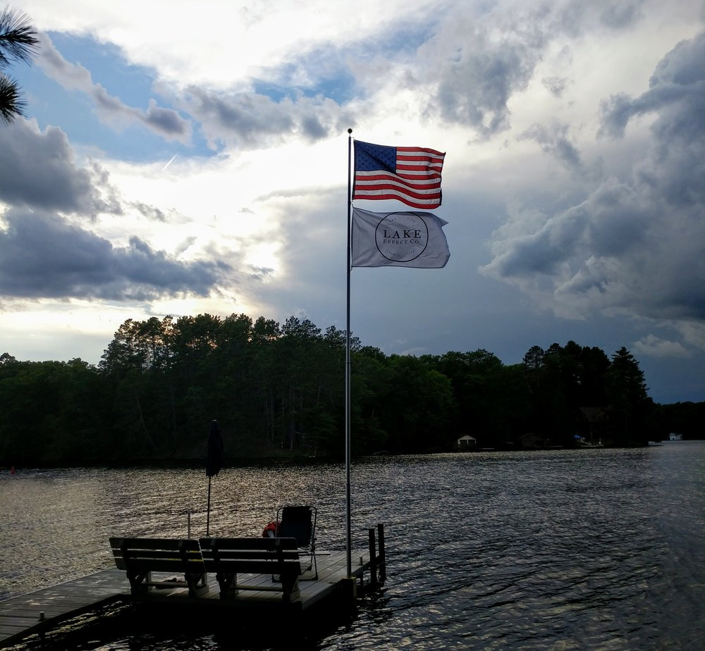 American Flag and Lake Effect Co Make Waves pennant on a pier