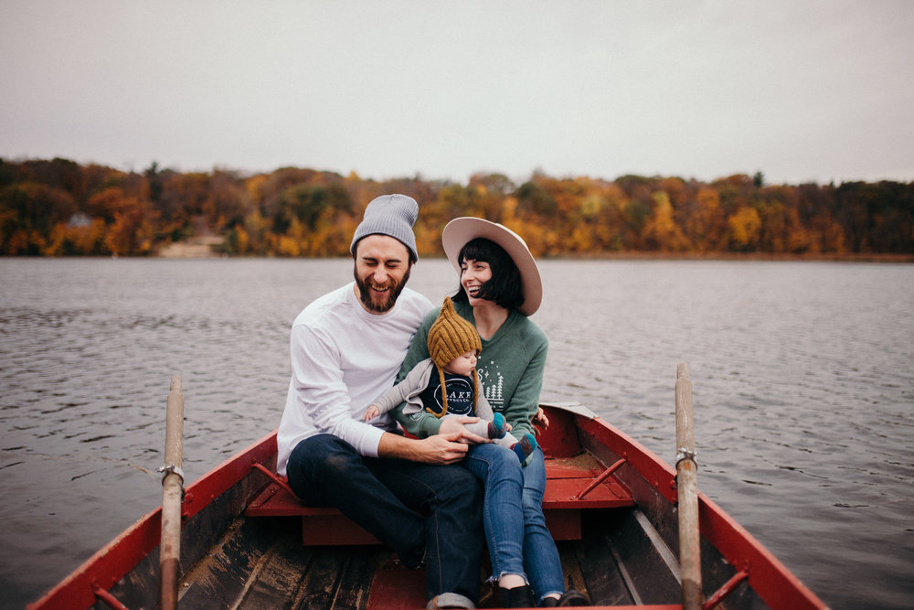 Couple and a baby wearing Northerly Vibes sweatshirt from Lake Effect Co