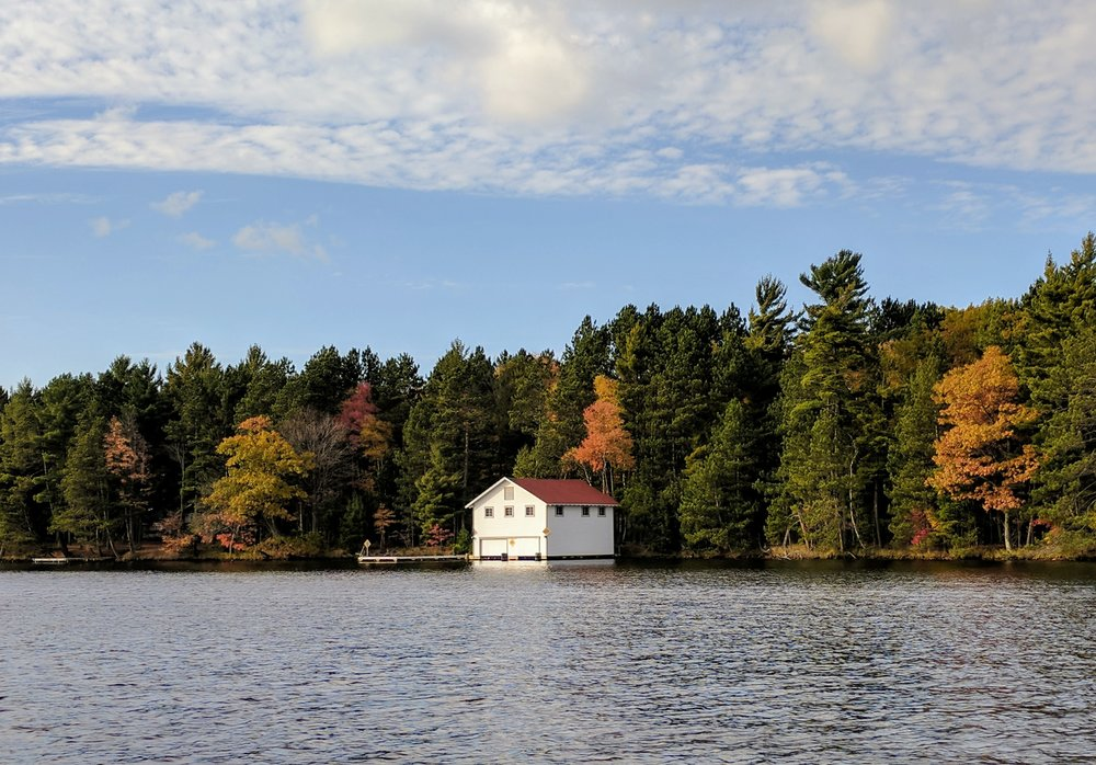 fall autumn boat house on a lake in northern wisconsin