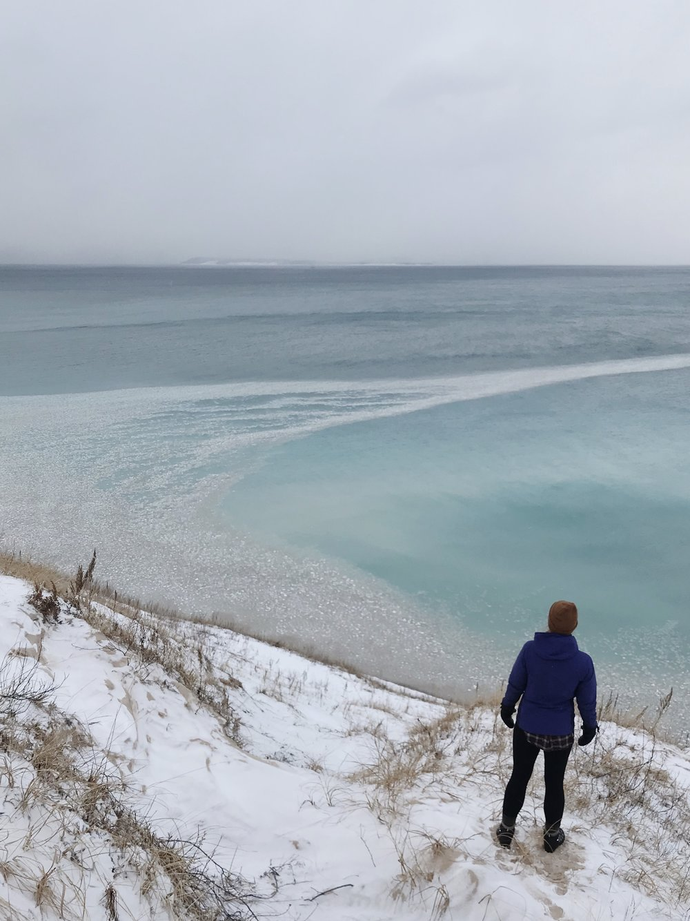 Woman in winter overlooking Lake Michigan