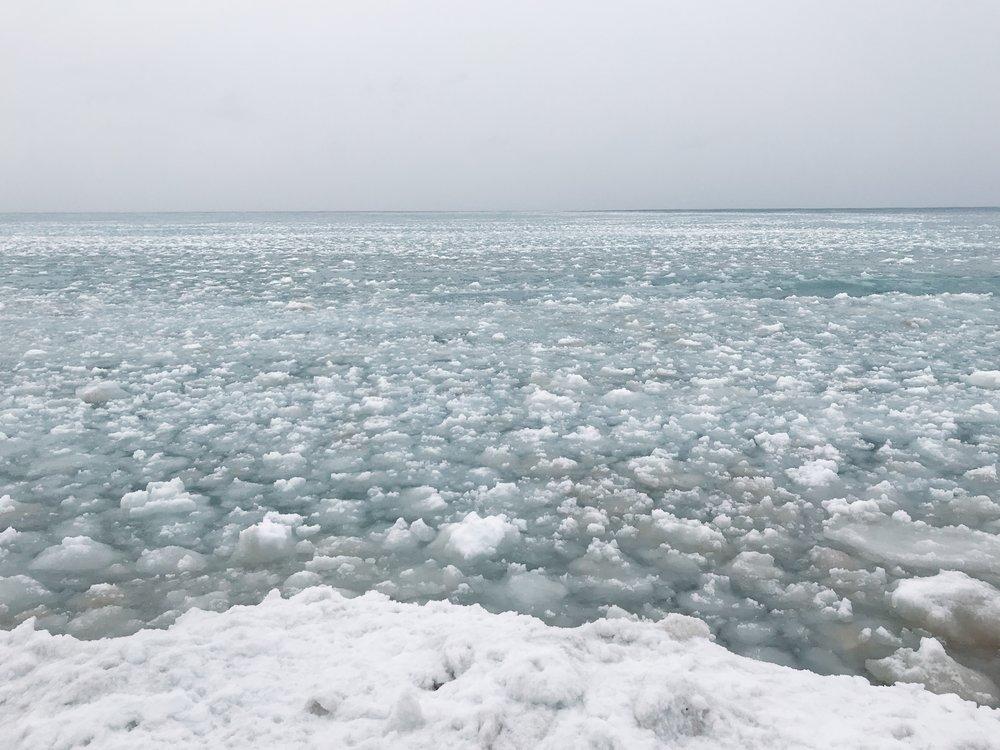Floating ice chunks in Lake Michigan near shore