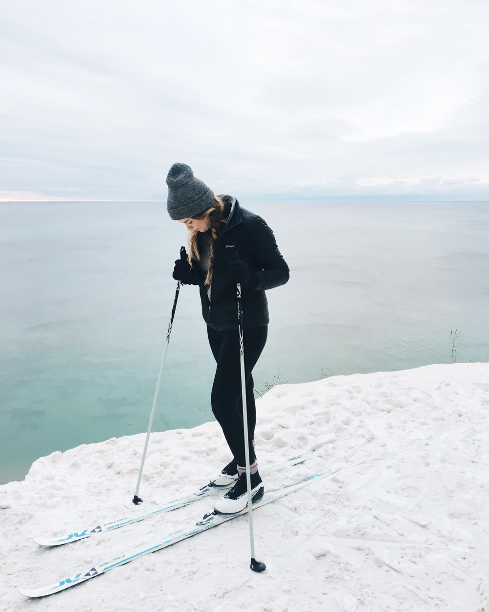 Woman cross country skiing along the Lake Michigan shoreline in winter