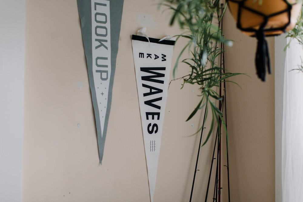 Look up and Mave waves pennant hanging on wall indoors by fishing poles