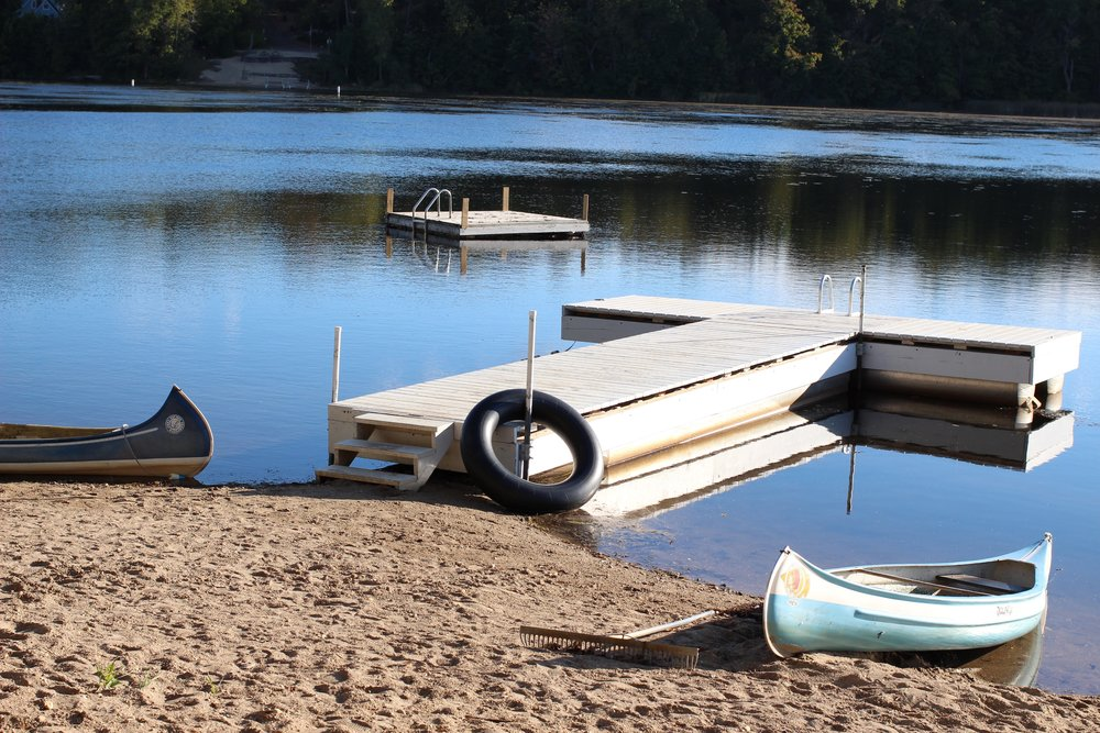 Canoes and Pier at Camp Wandawega in the summer