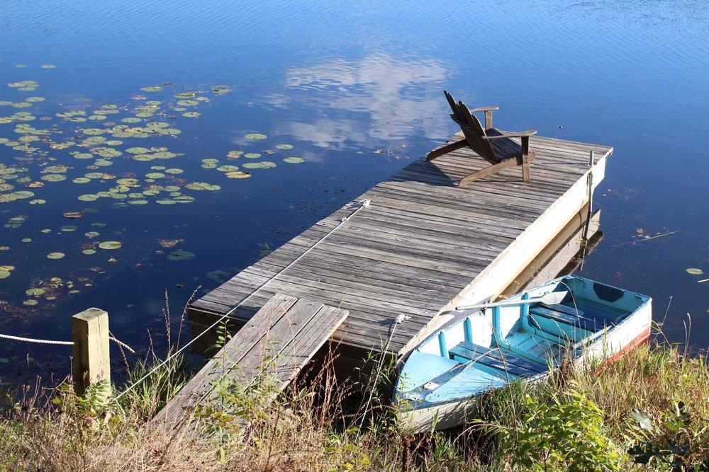 pier and old rowboat on wisconsin lake wandawega