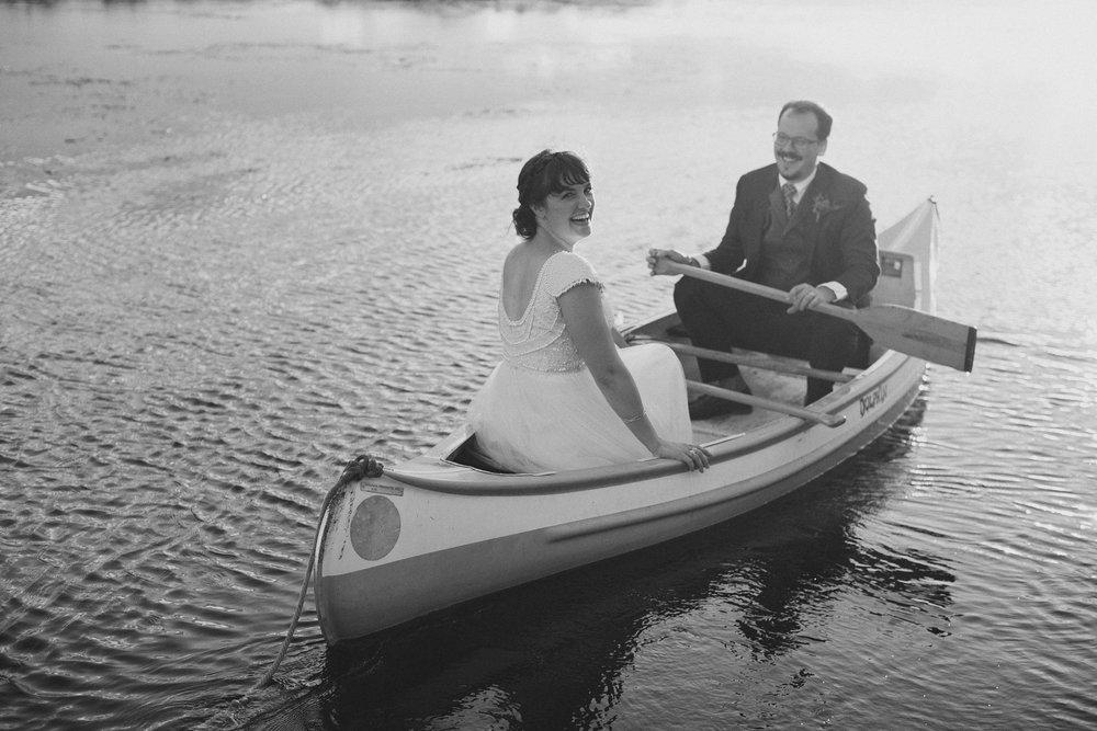 Bride and groom in a canoe at lake wandawega