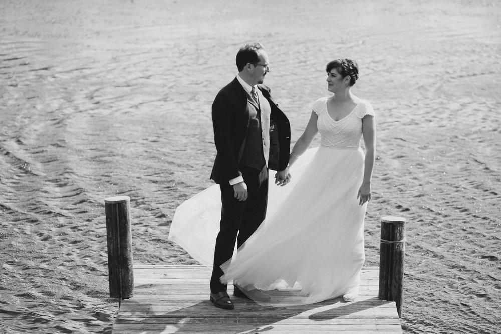 bride and groom on pier at camp wandawega