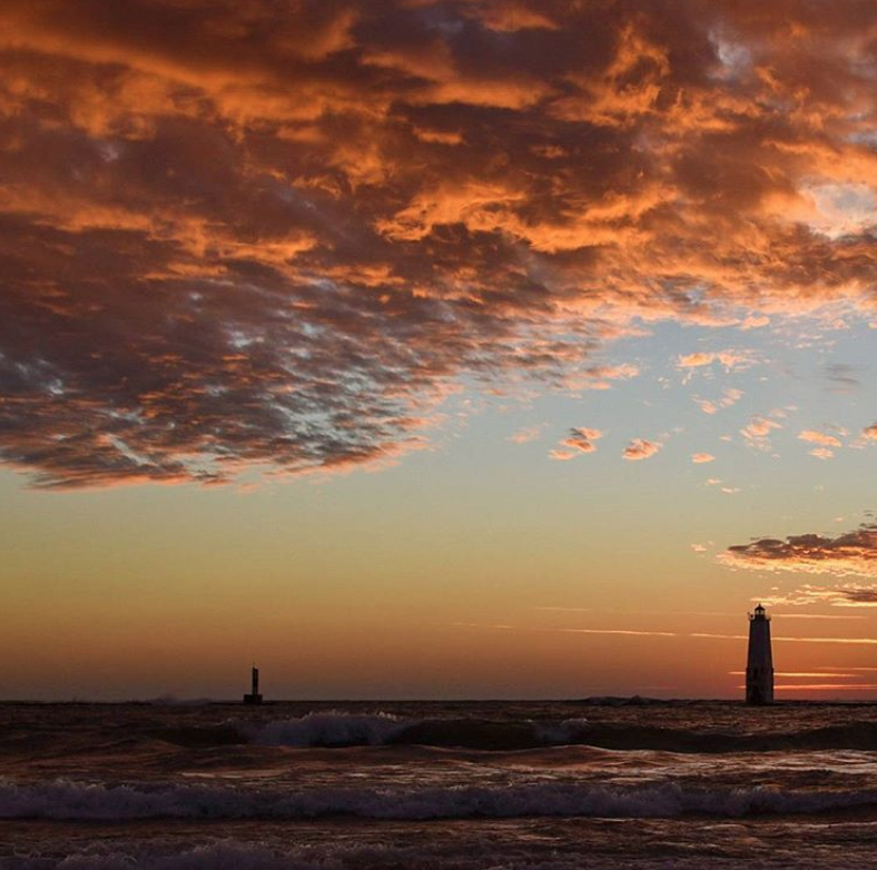 Sunset over lake michigan with lighthouse