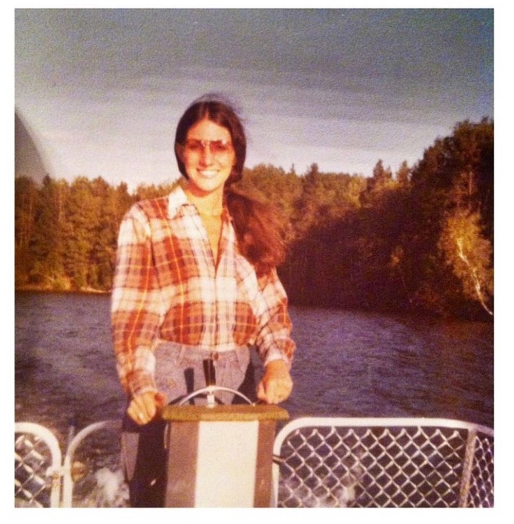 Vintage photo of woman driving a boat